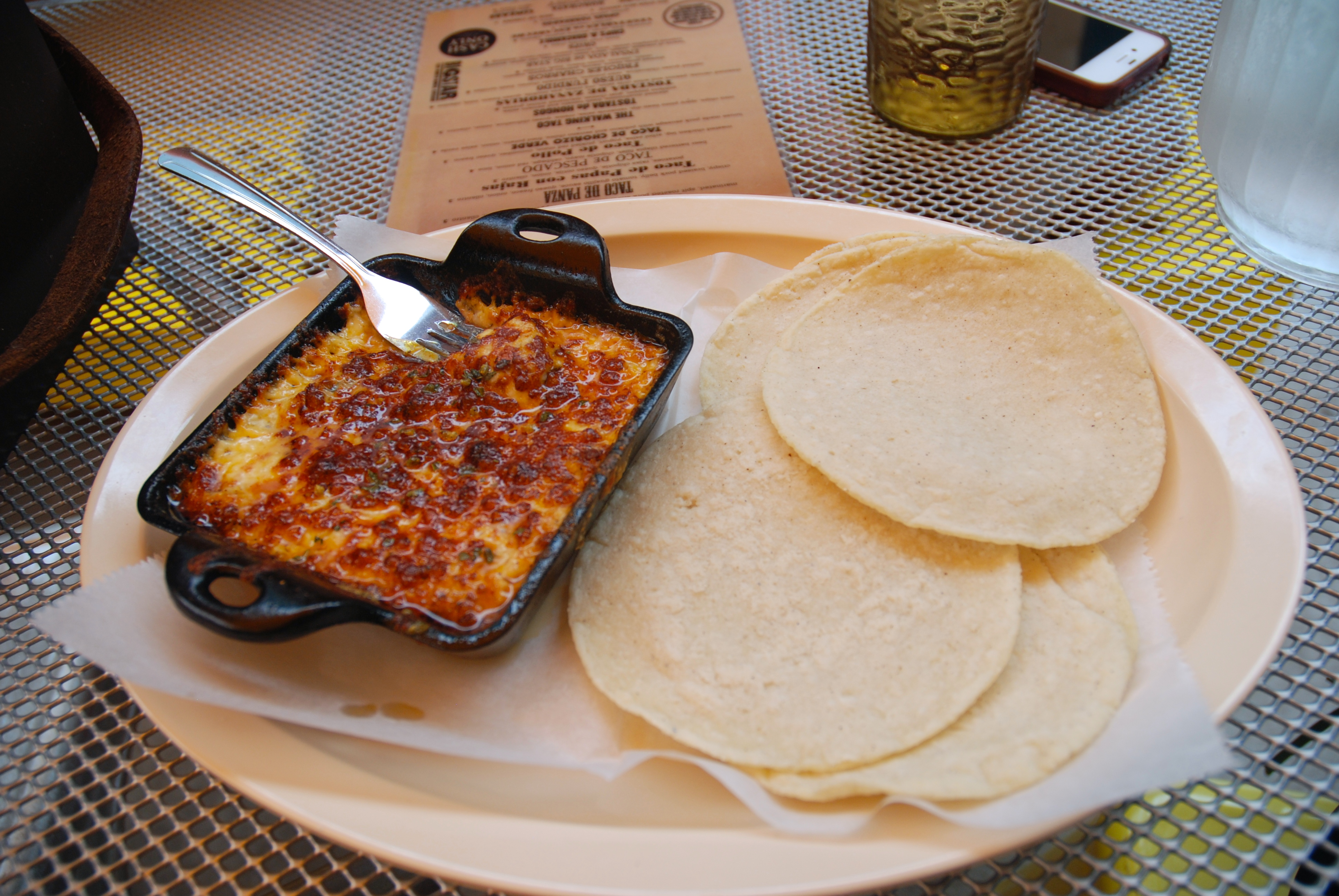 Queso Fundido - served with fresh corn tortillas.