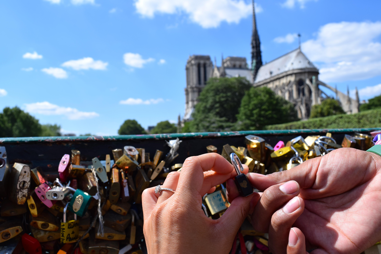 Leaving our mark at Pont de l'Archevêché - aka The Love Lock Bridge - as a newly engaged couple - Paris, France.